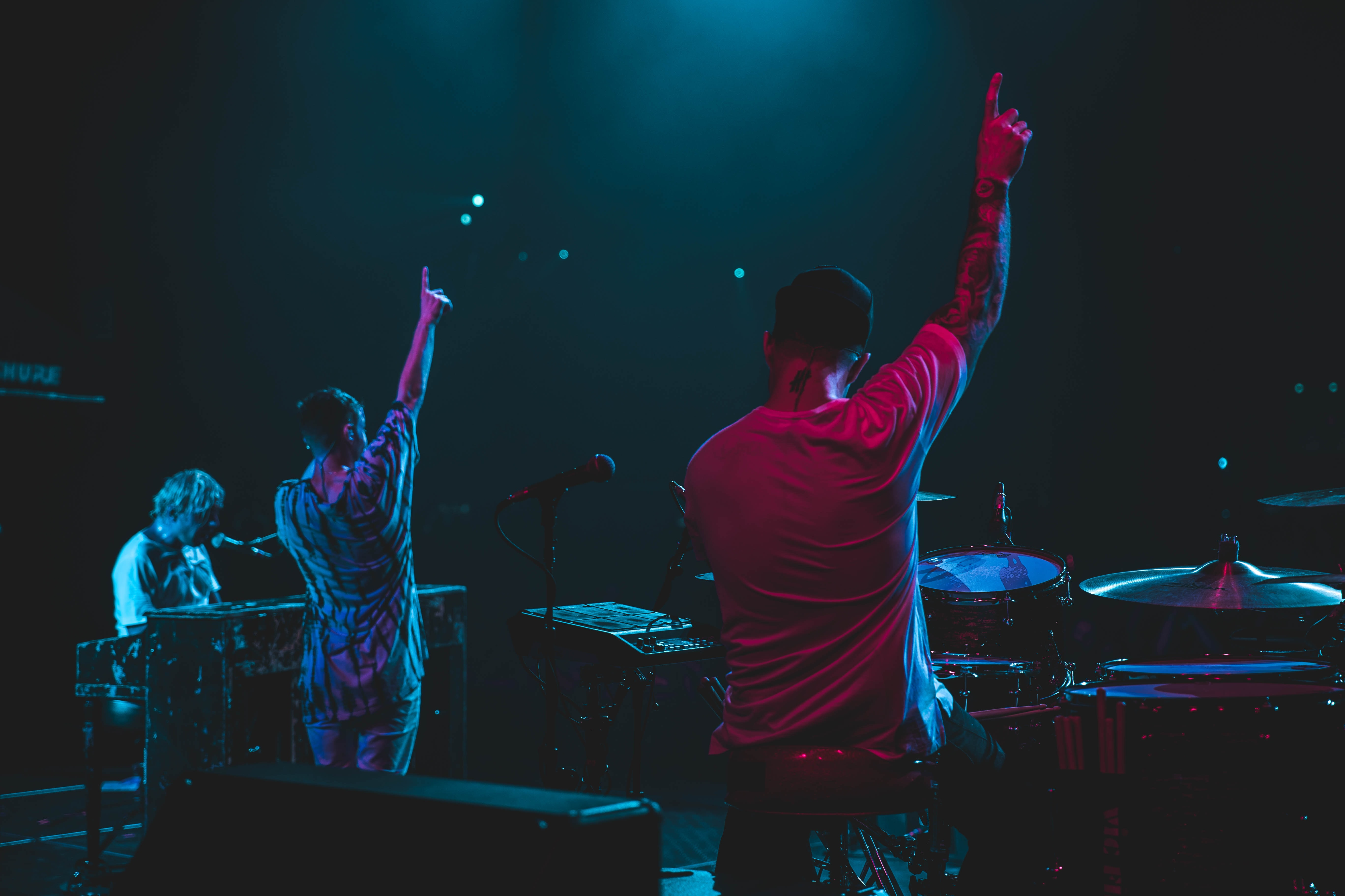 two person raising hands