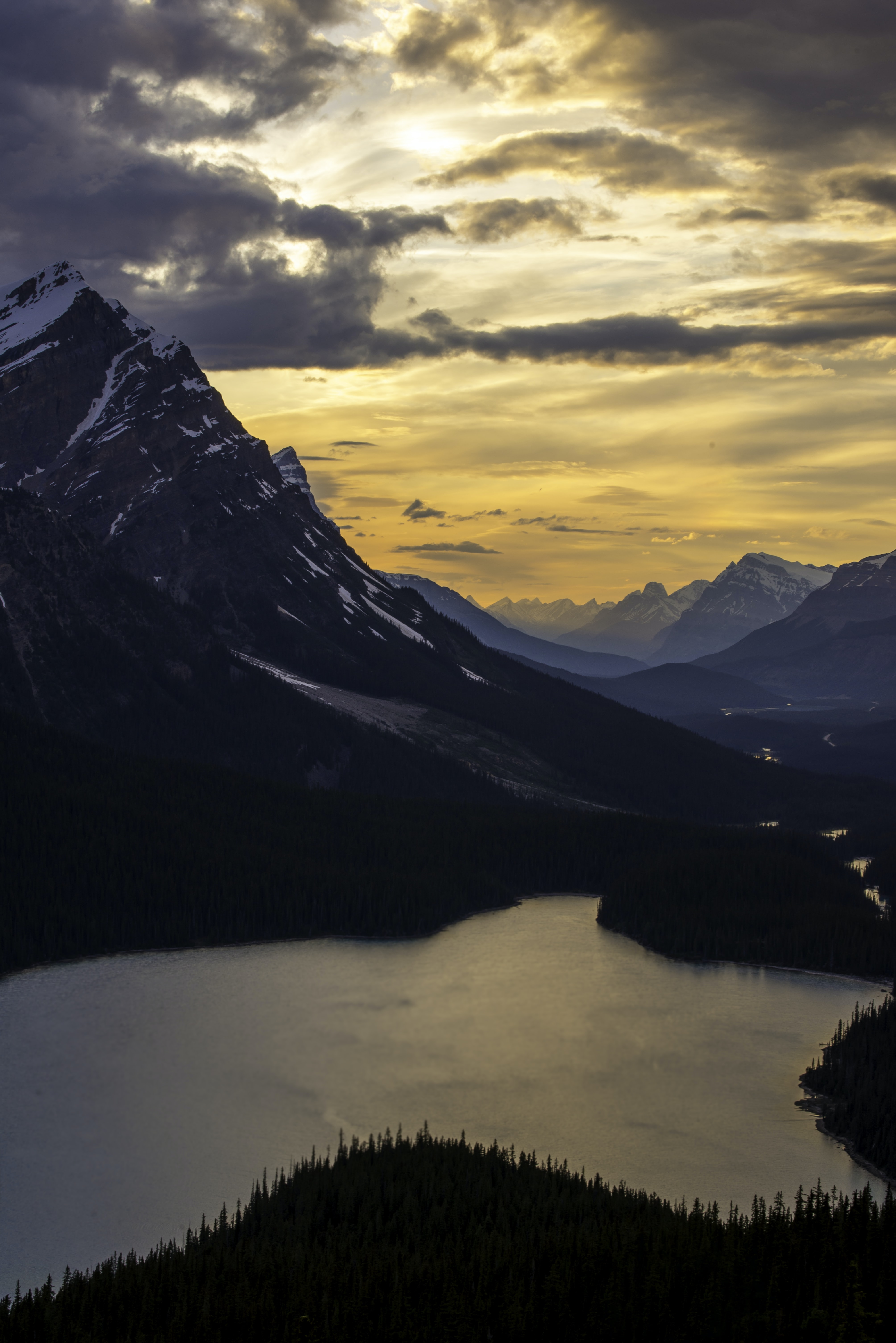 photo of lake near mountain at golden hour