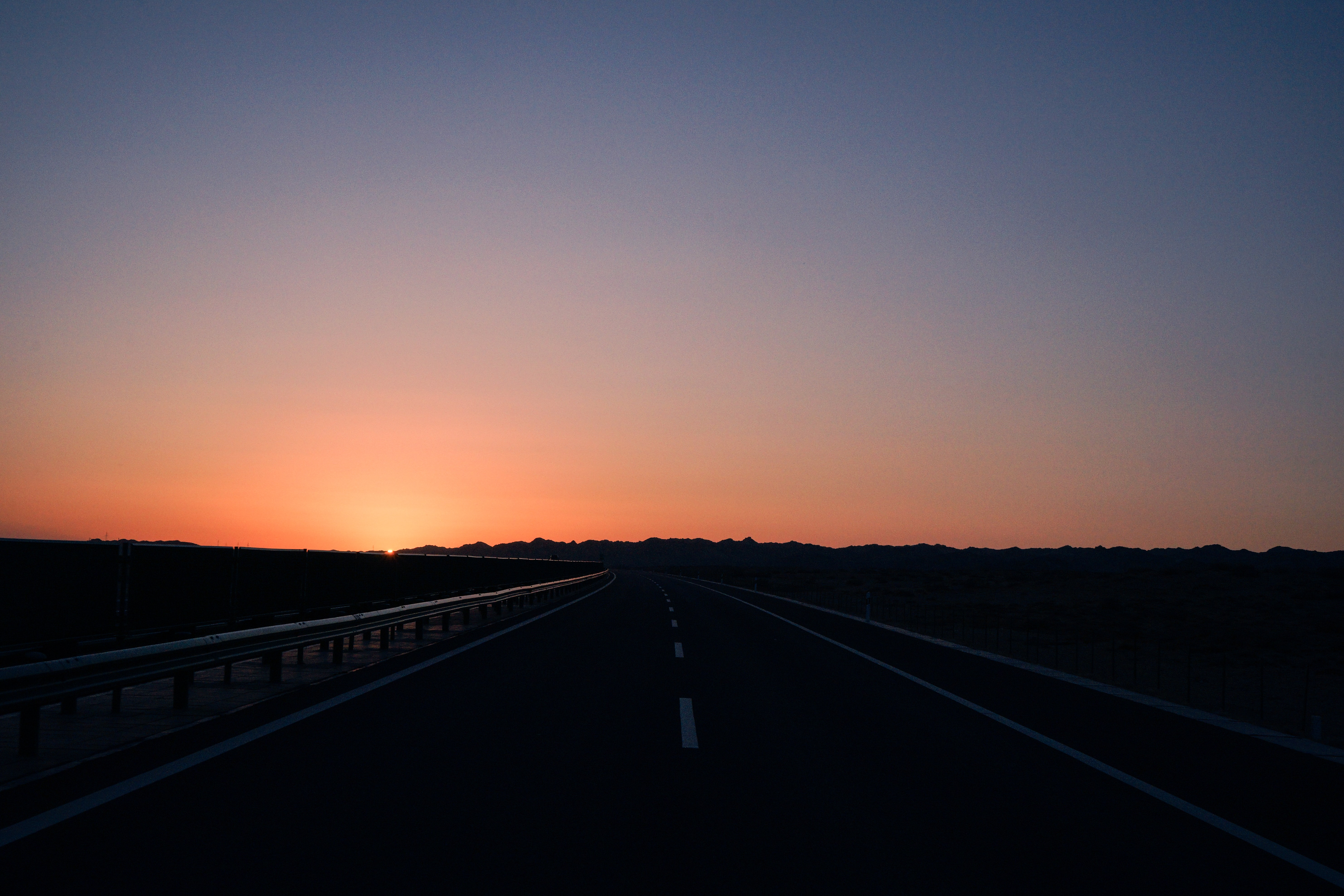 view of empty road during sunset