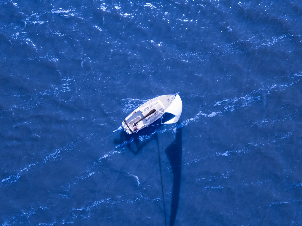 aerial view of boat sailing on blue ocean