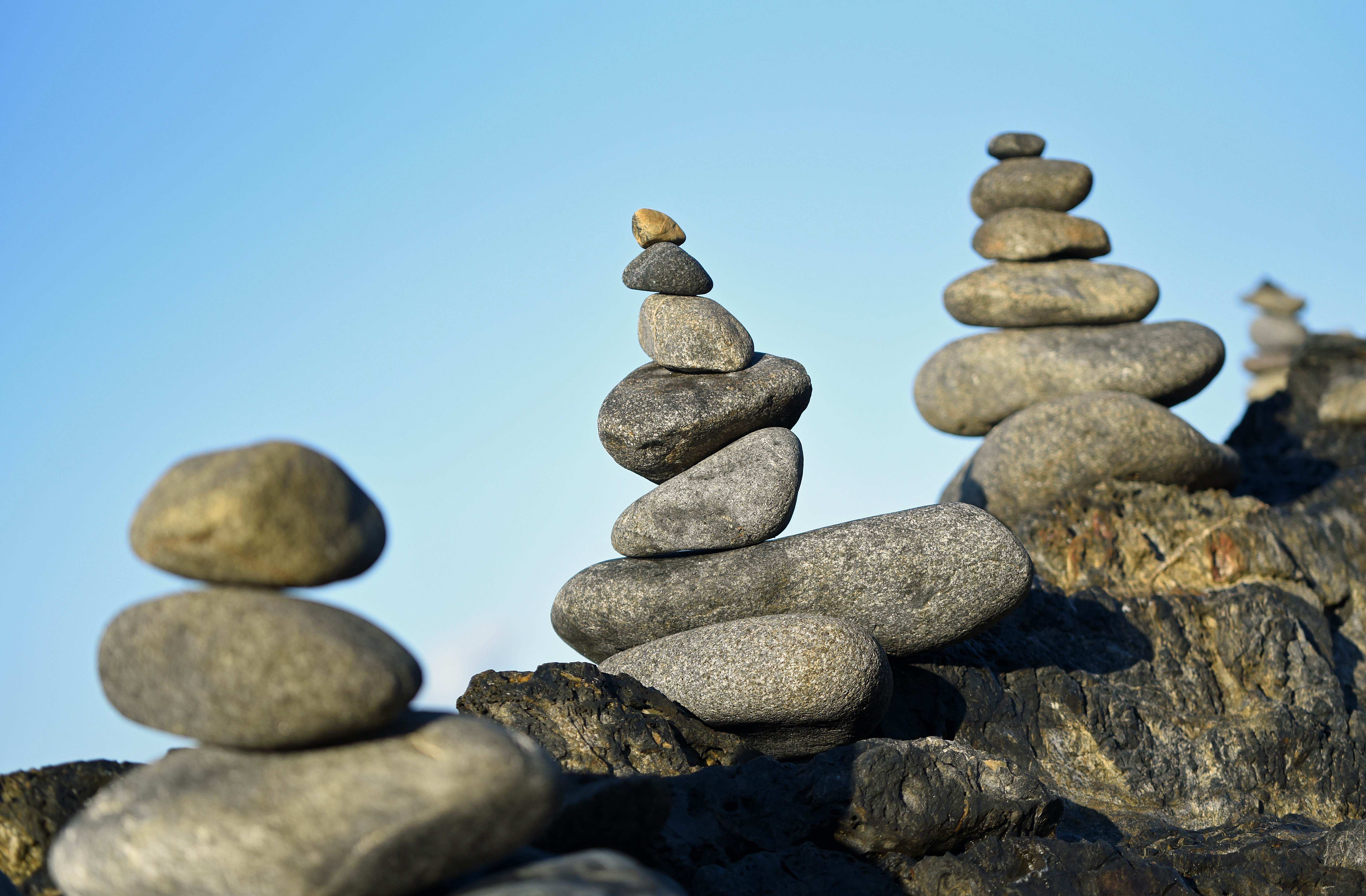 selective focus photography of stacked balance stones