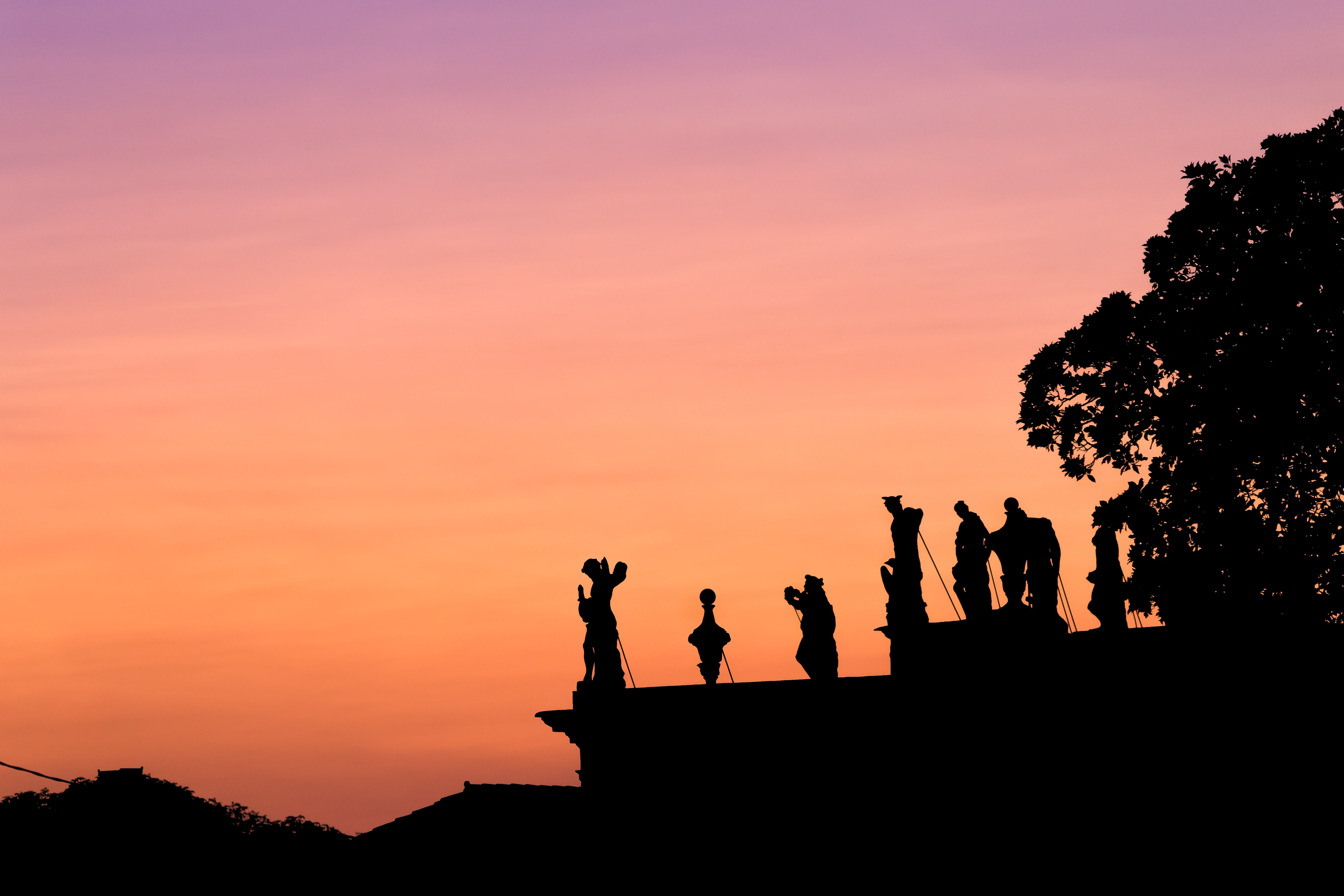 silhouette of people on top of mountain