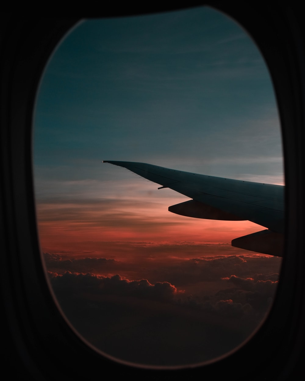 window view of airplane during golden hour