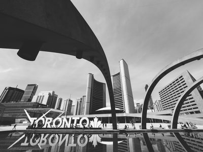 grayscale photo of city structure zoom background