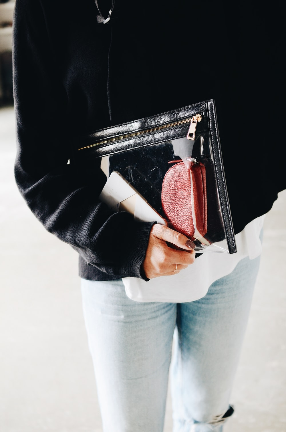person holding pouch bag