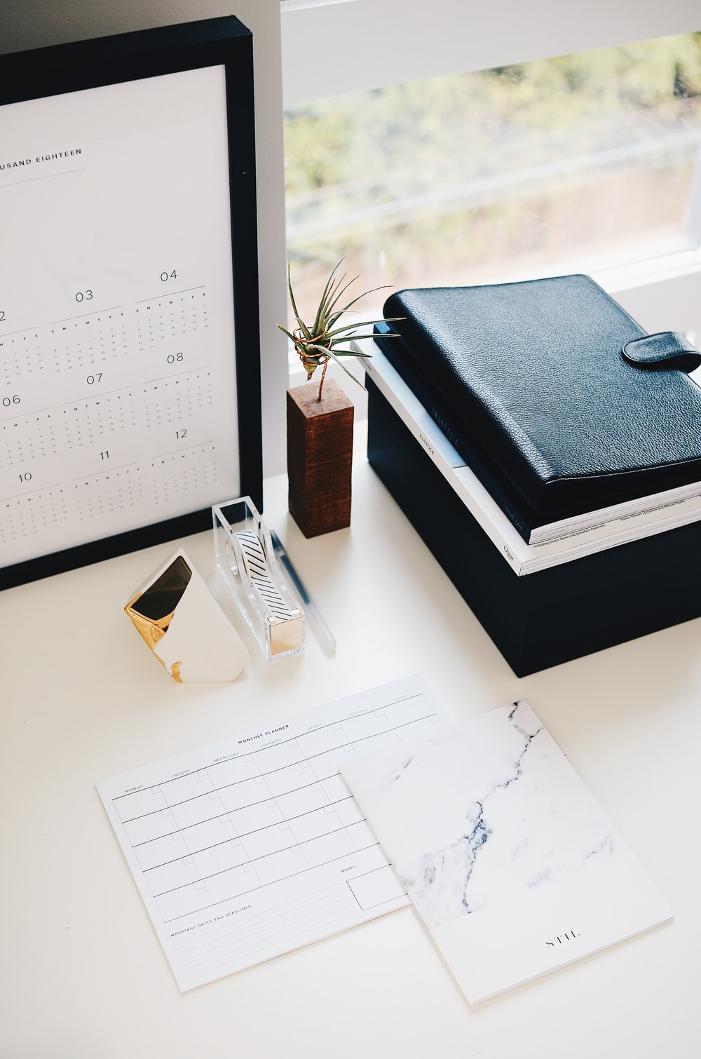 books and calendar on white table
