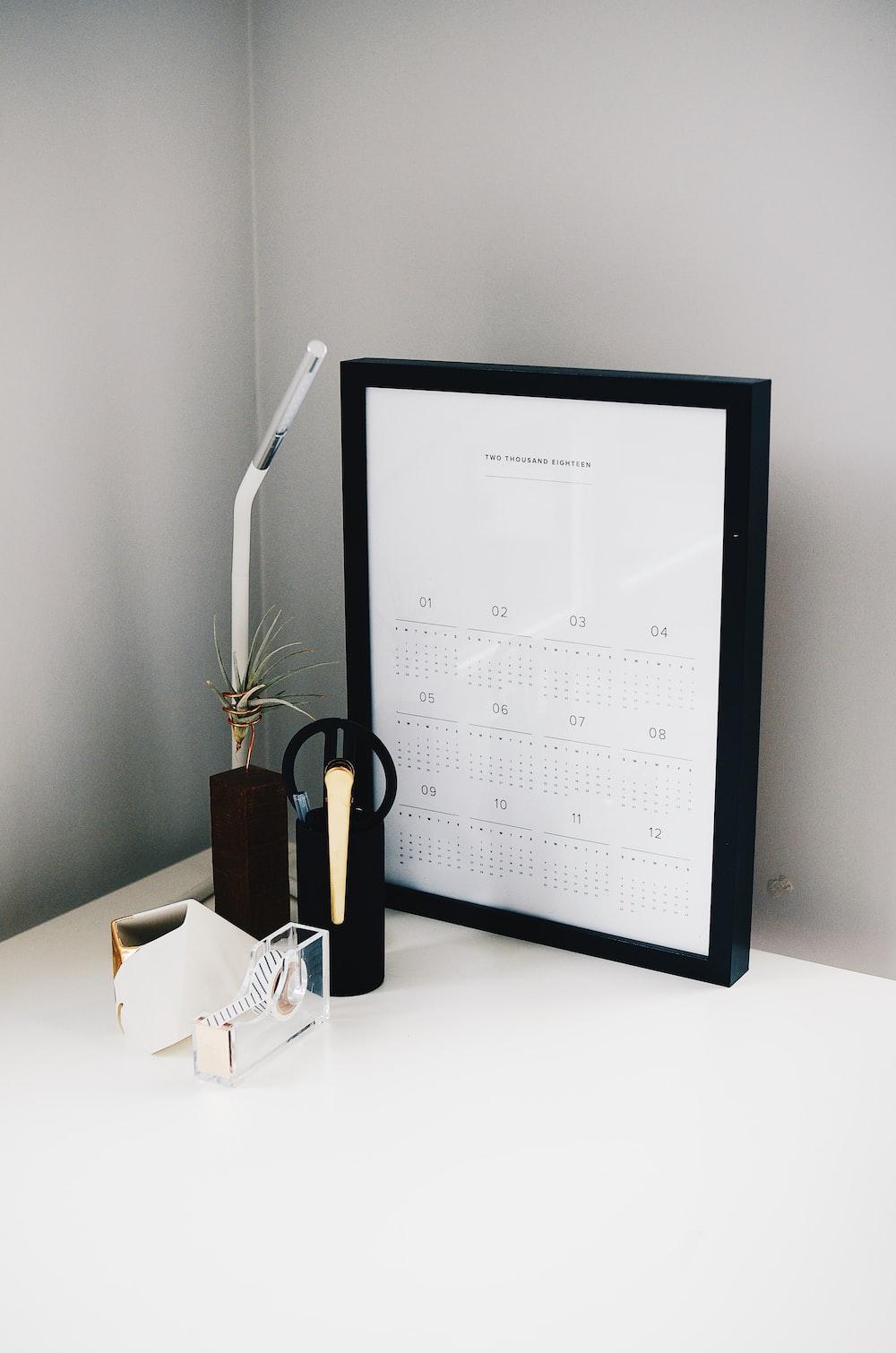 calendar with black frame on table