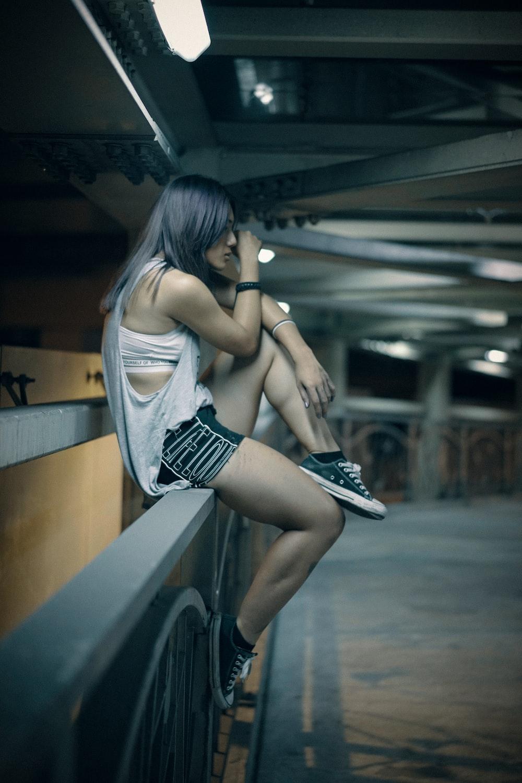woman sitting on railing