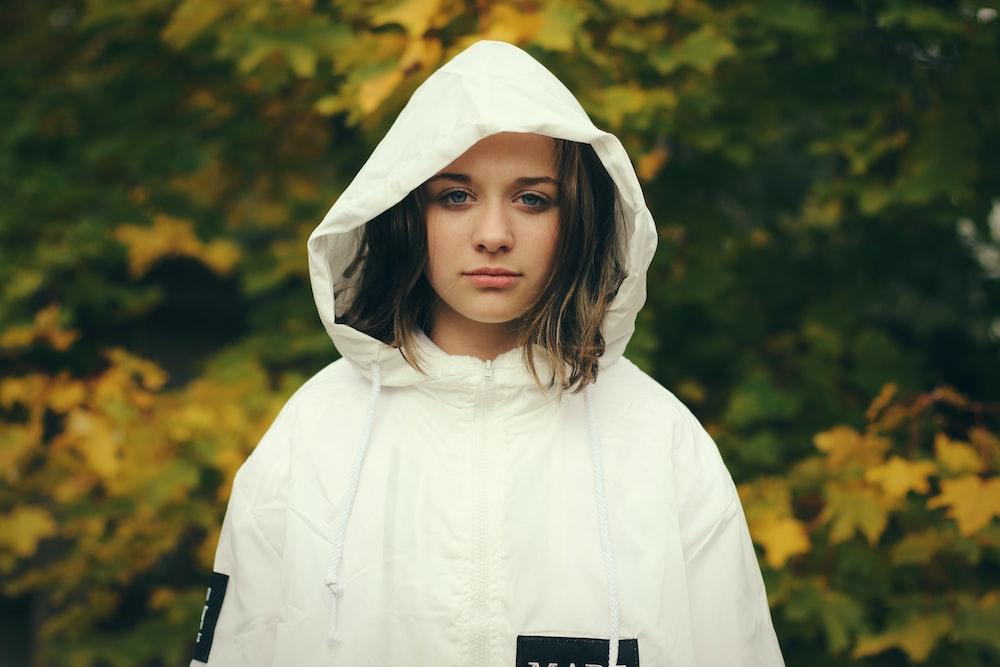 woman wearing white zip-up hoodie jacket