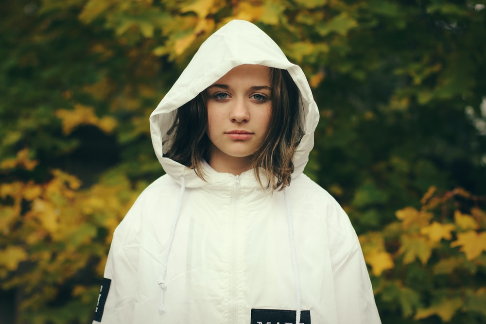 woman wearing white zip-up hoodie jacket
