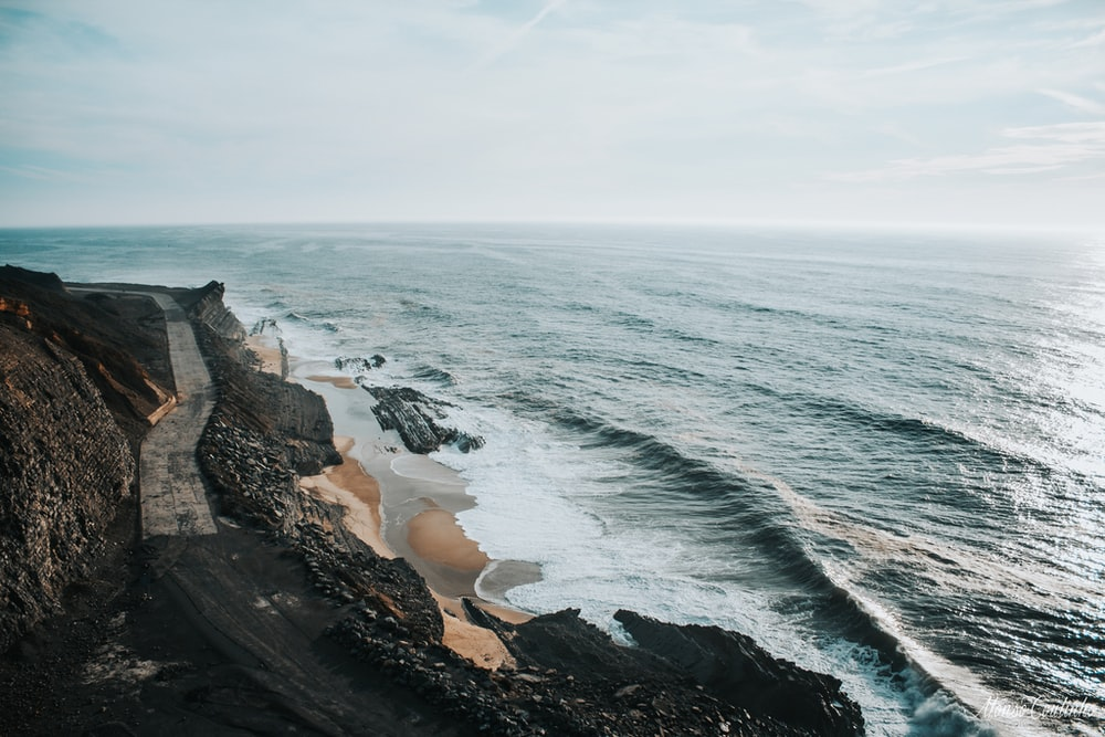 body of water near on the cliff