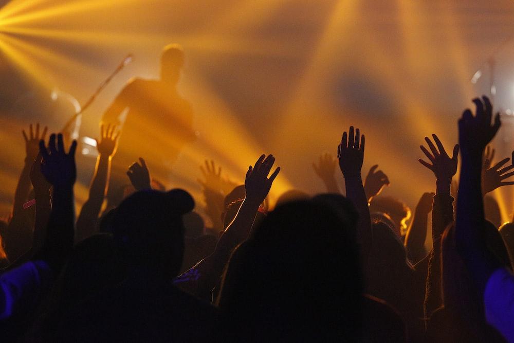 people jamming while man singing on stage
