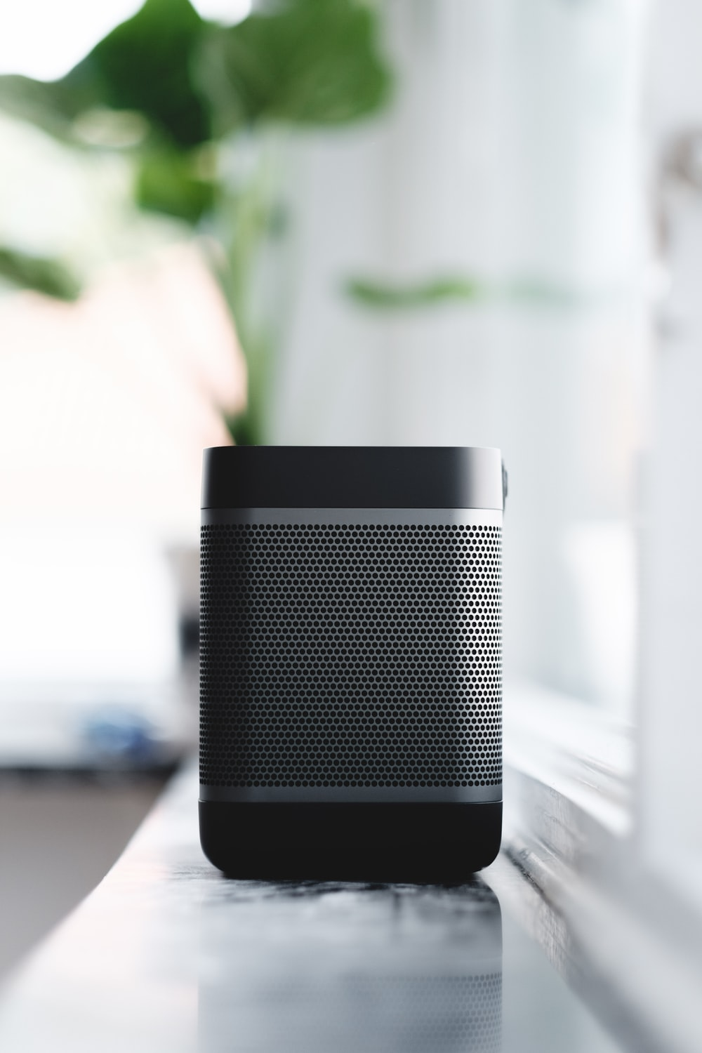 selective focus photography of black and gray portable speaker