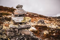 gray stacked rocks on a mountain