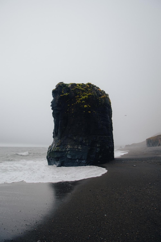 butte near body of water