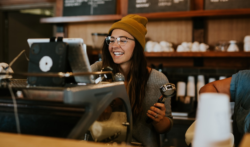 barista holding coffee filter for how to make money as an empath