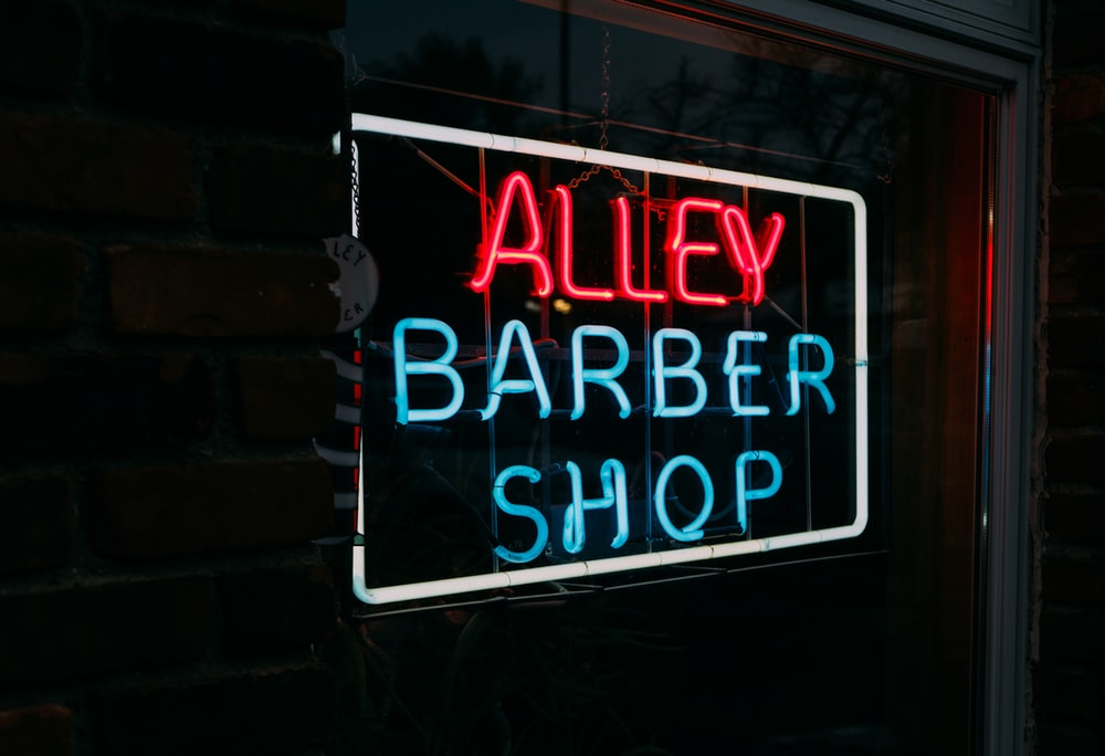 alley barber shop neon light signage