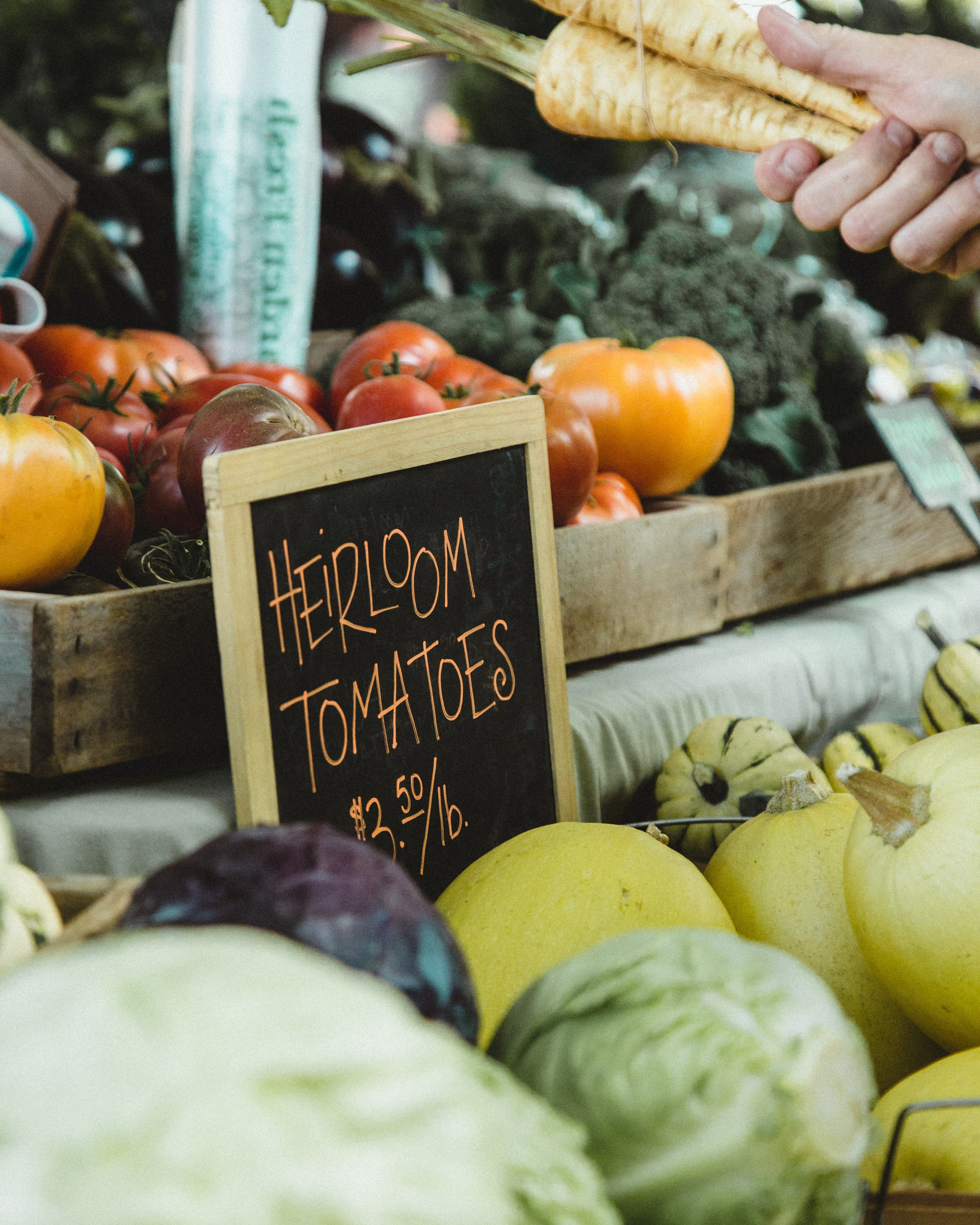 focus photography of heirloom tomatoes board signage