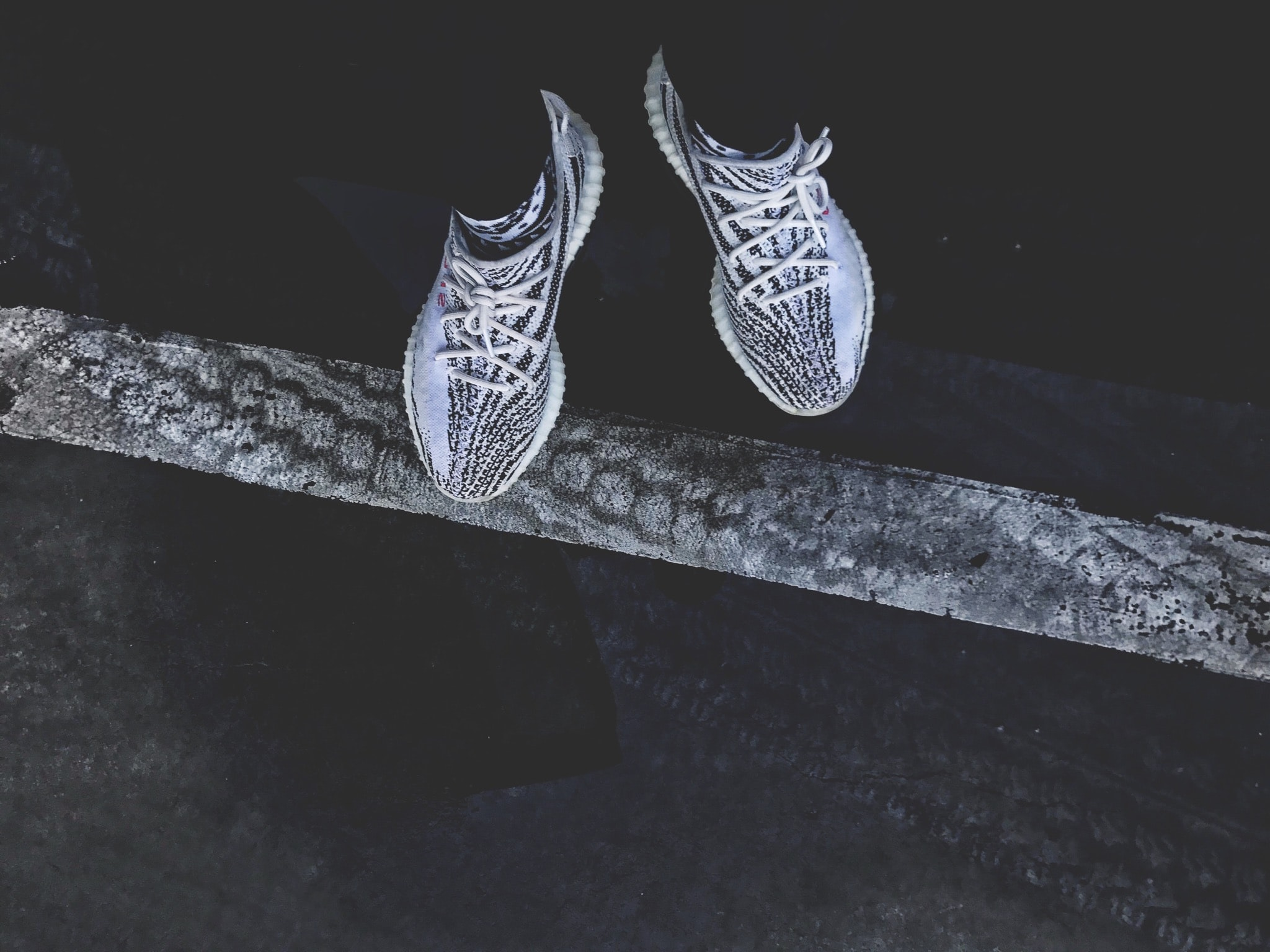 pair of gray-and-black adidas Yeezy Boost 350's