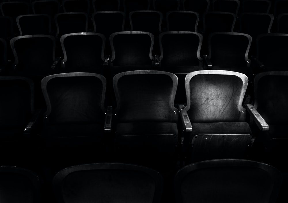 grayscale photography of cinema chair