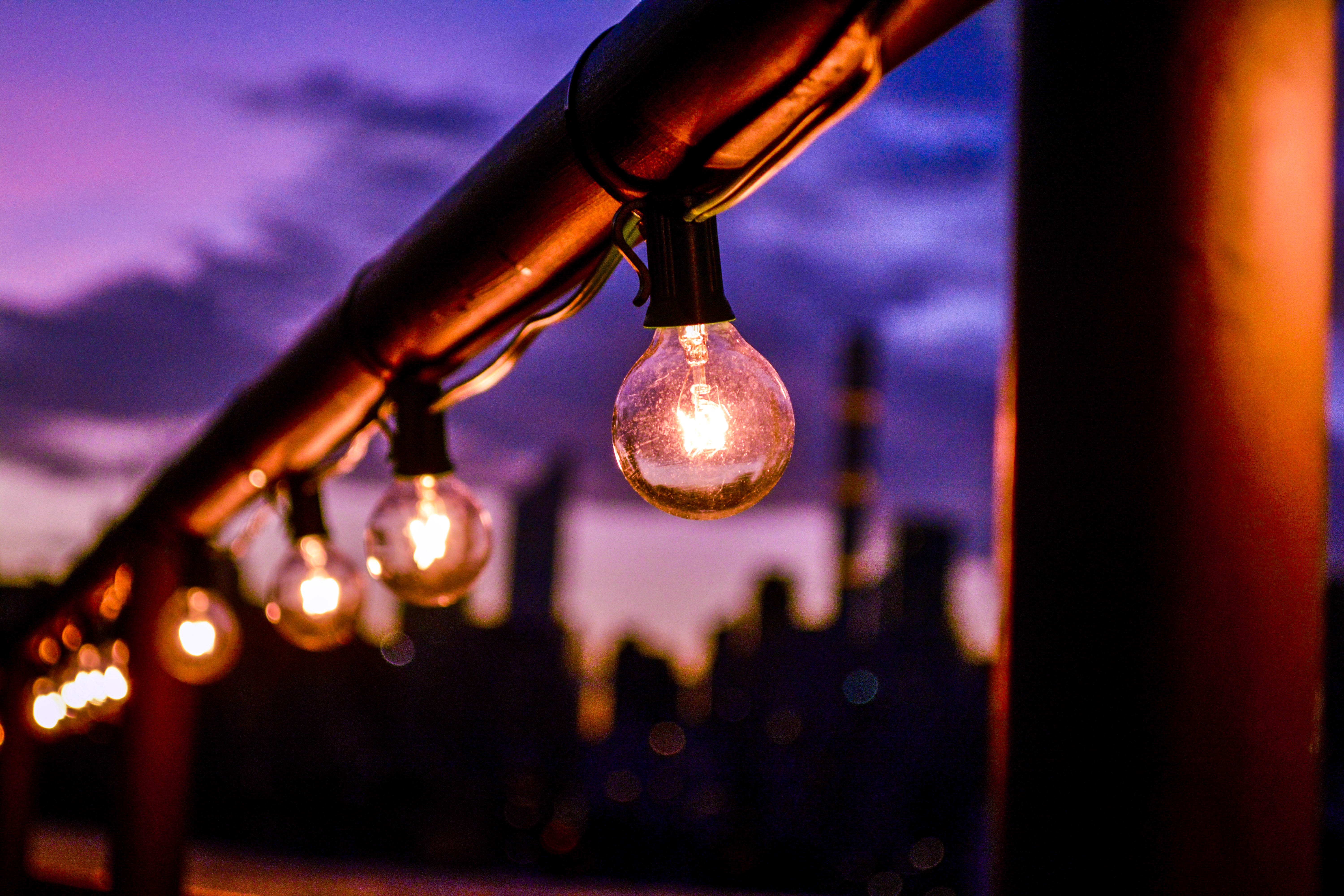 incandescent bulbs hanging on red steel frame