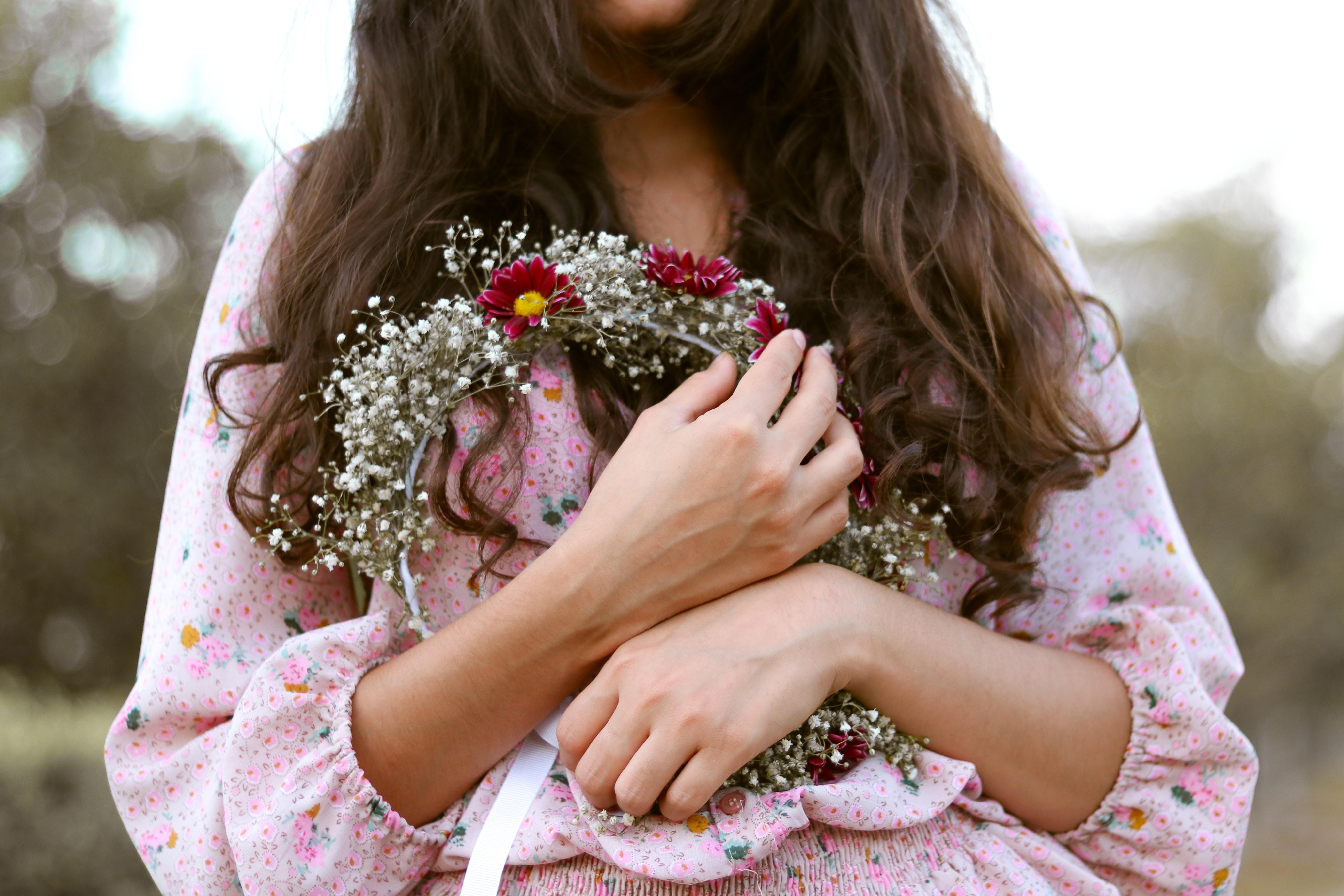 woman holding floral headband