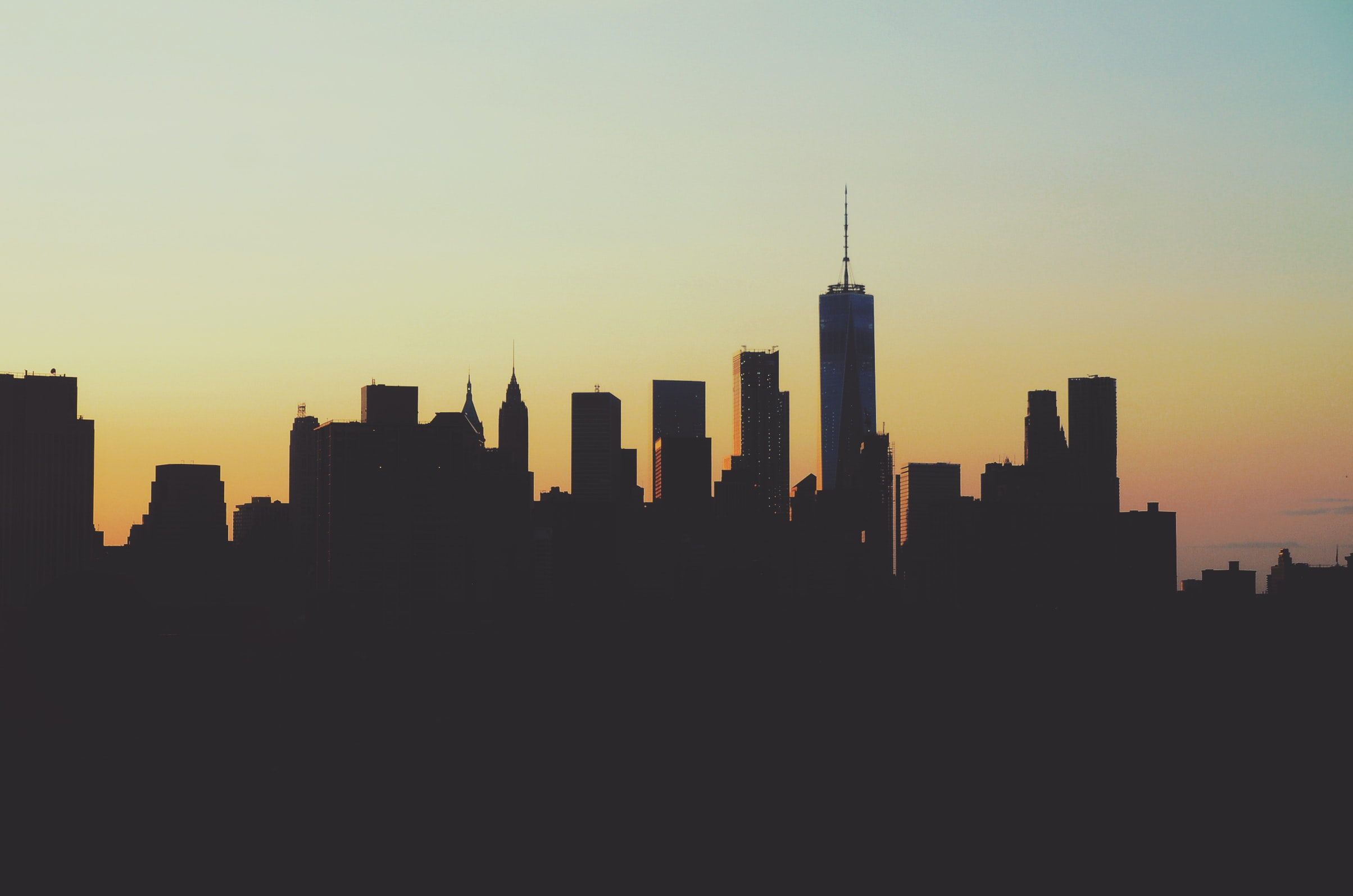 silhouette photography of high-rise buildings