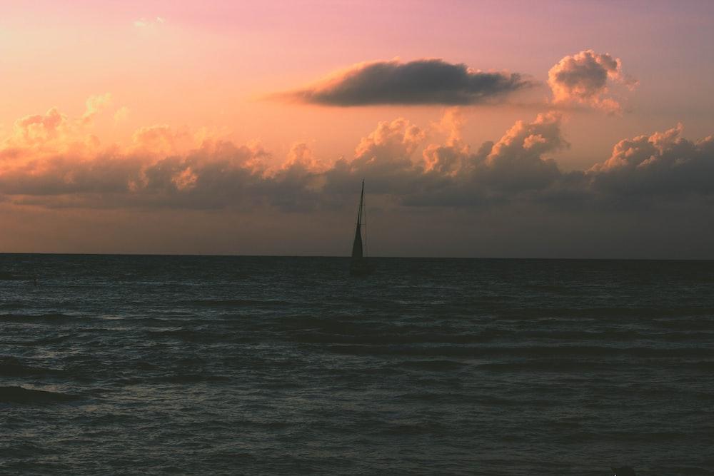 ocean under orange sky