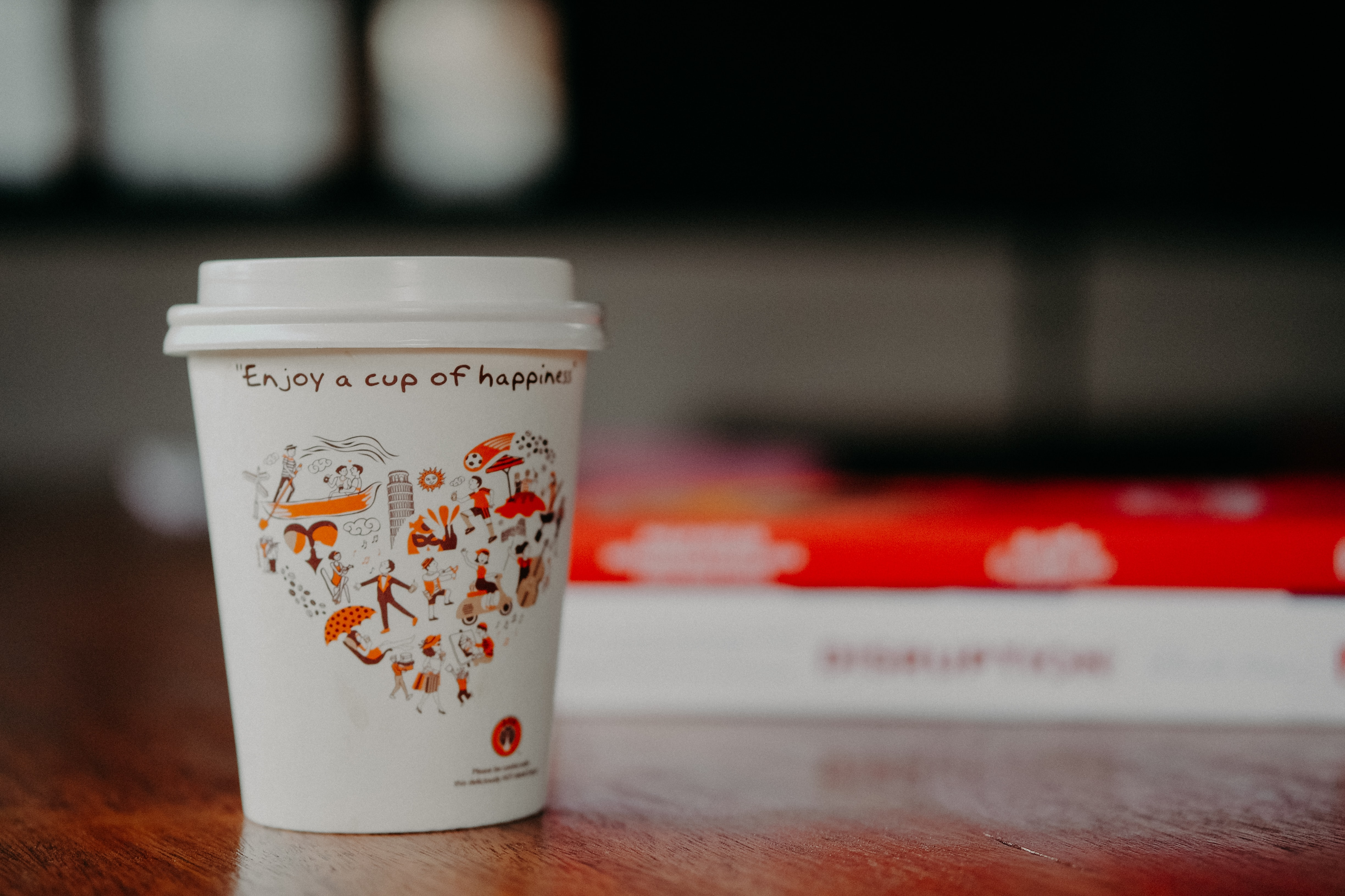 disposable cup shallow focus photography