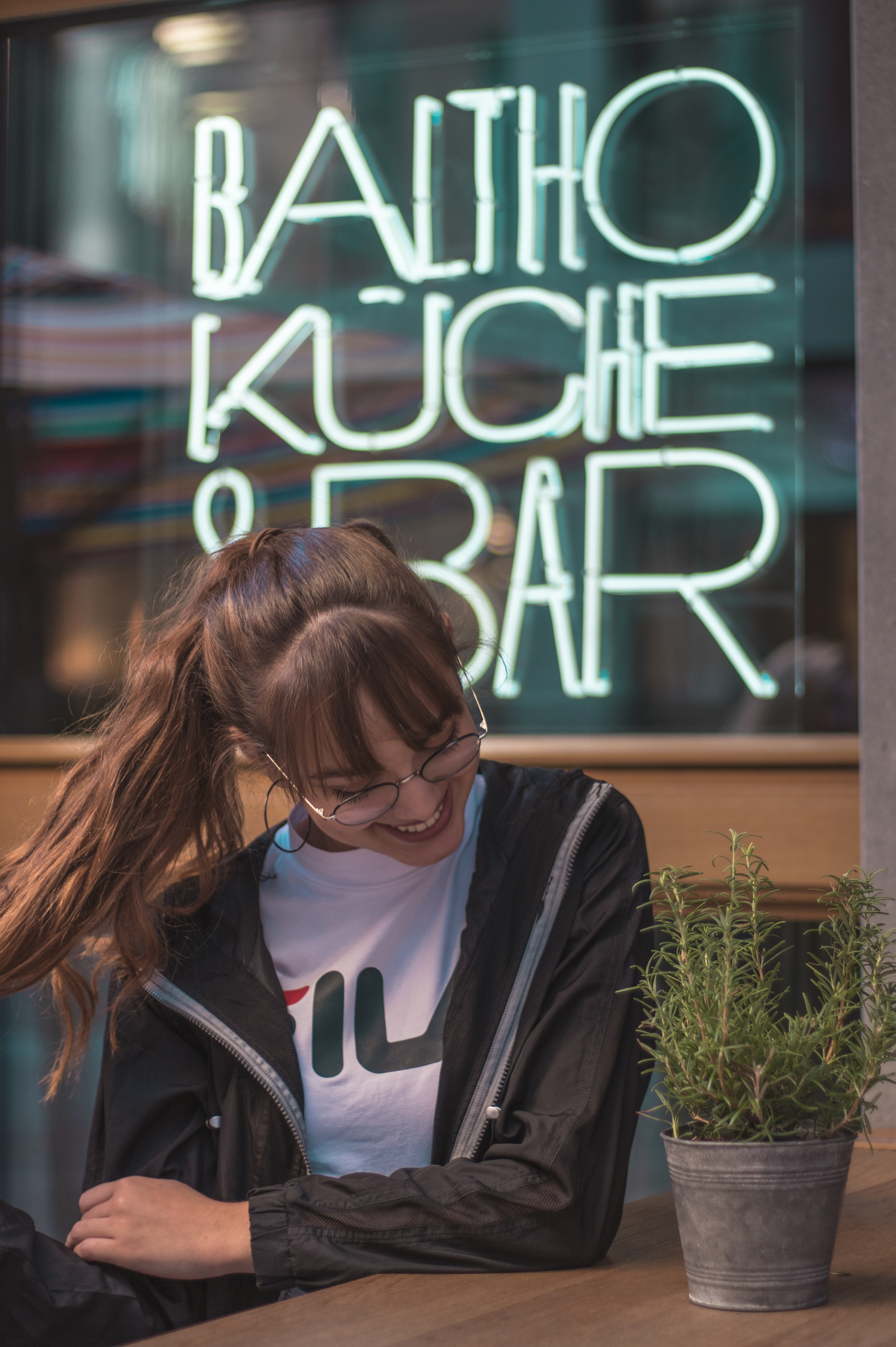 woman sitting outside Baltho Kuche and Bar during daytime