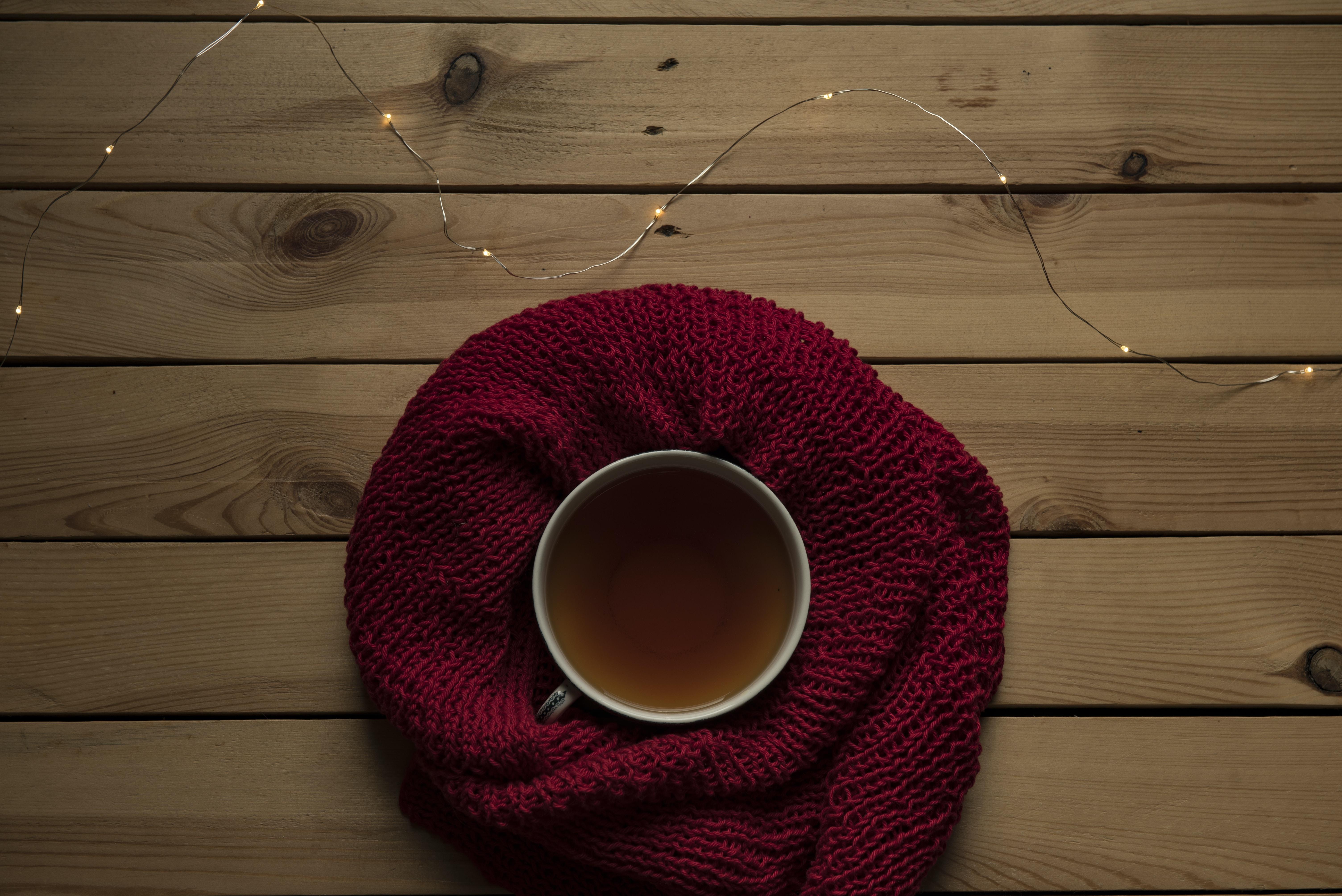 mug on red knit apparel