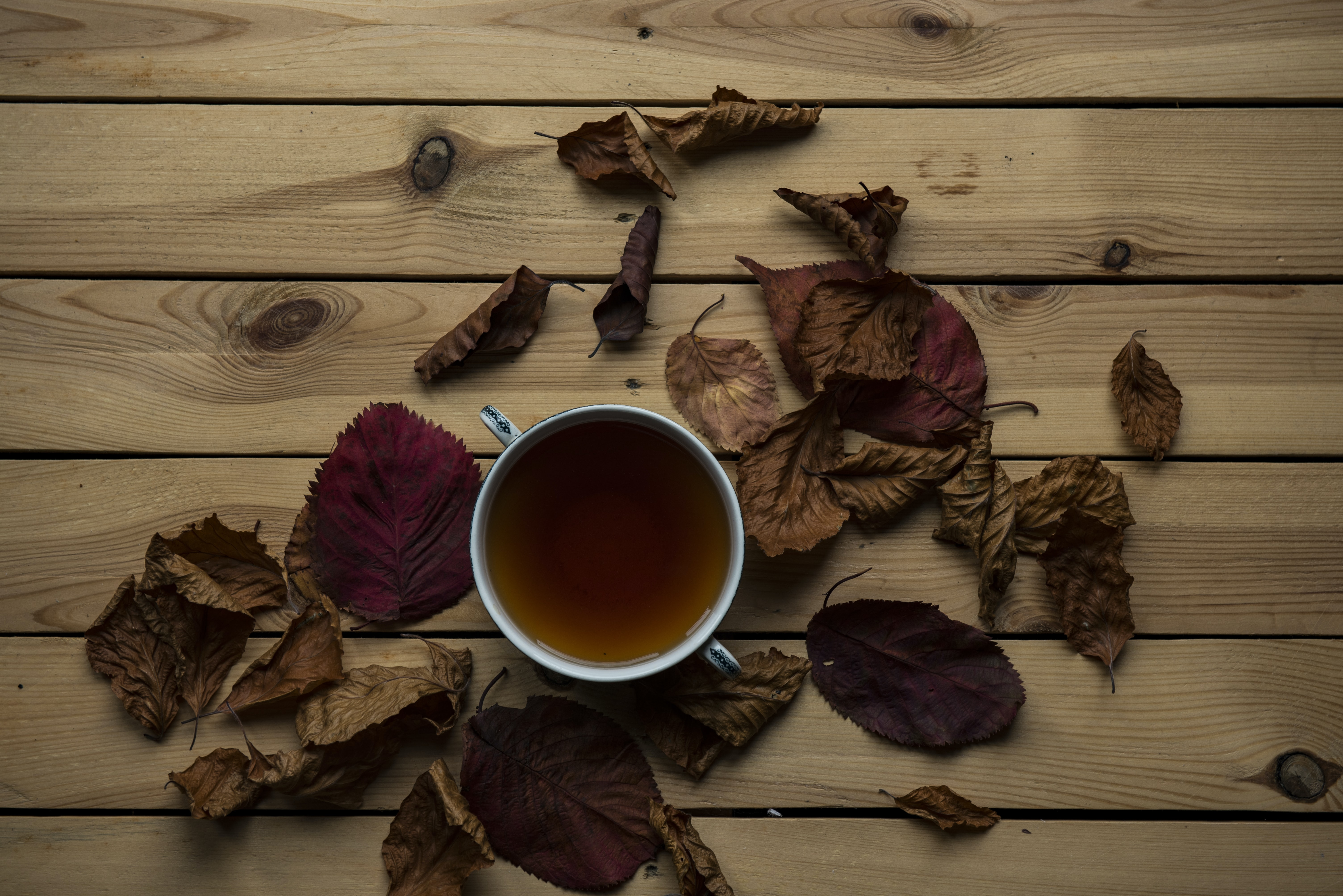 tea in cup on brown wooden surface