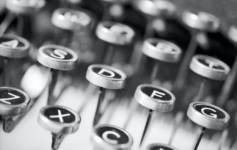 silver typewriter in shallow focus photography