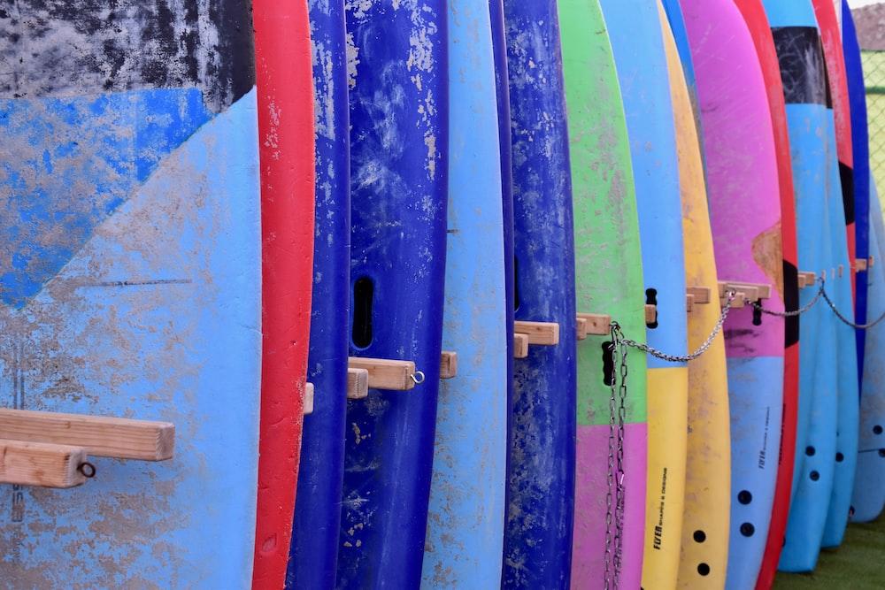 assorted-color surfboard set