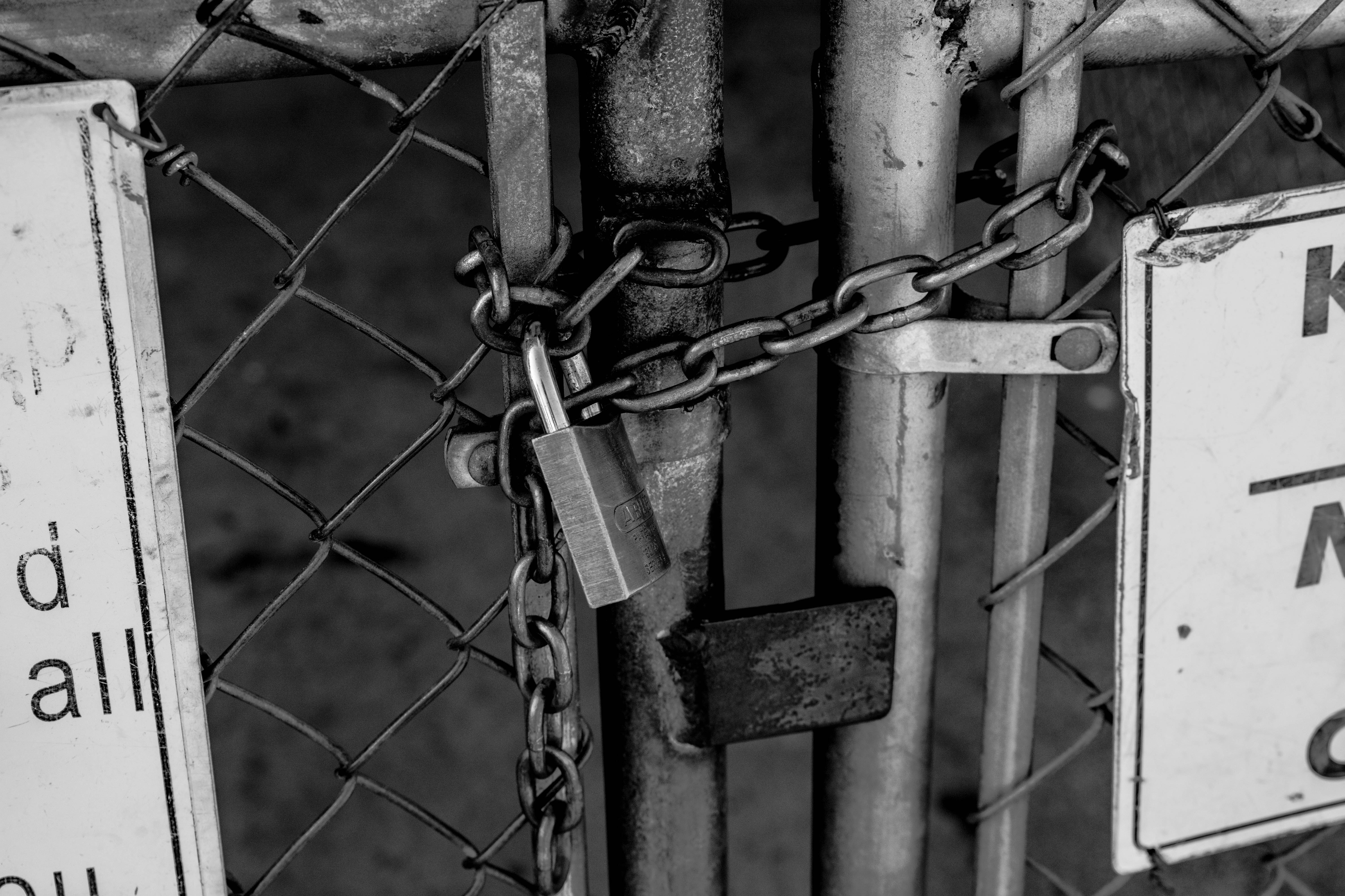 grayscale photo of chain and padlock