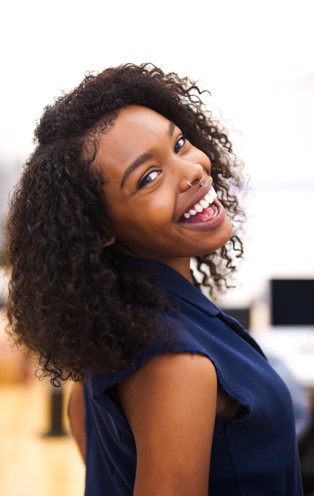 woman looking back while smiling