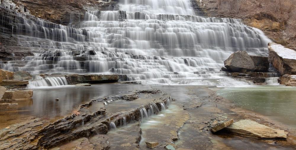 time-lapse photo of layered waterfalls