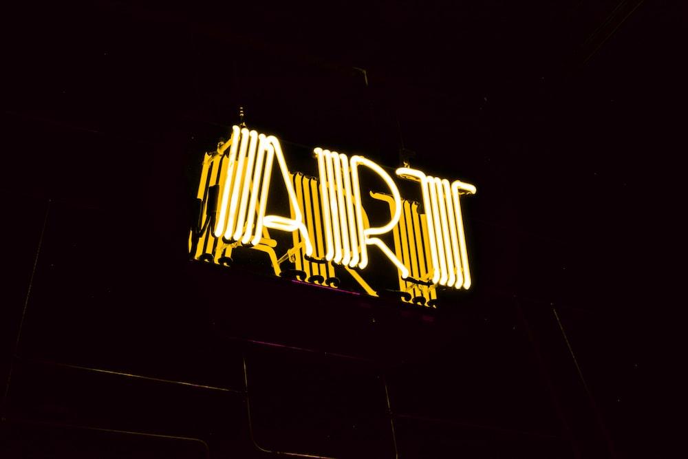 minimalist photography of yellow art neon light signage