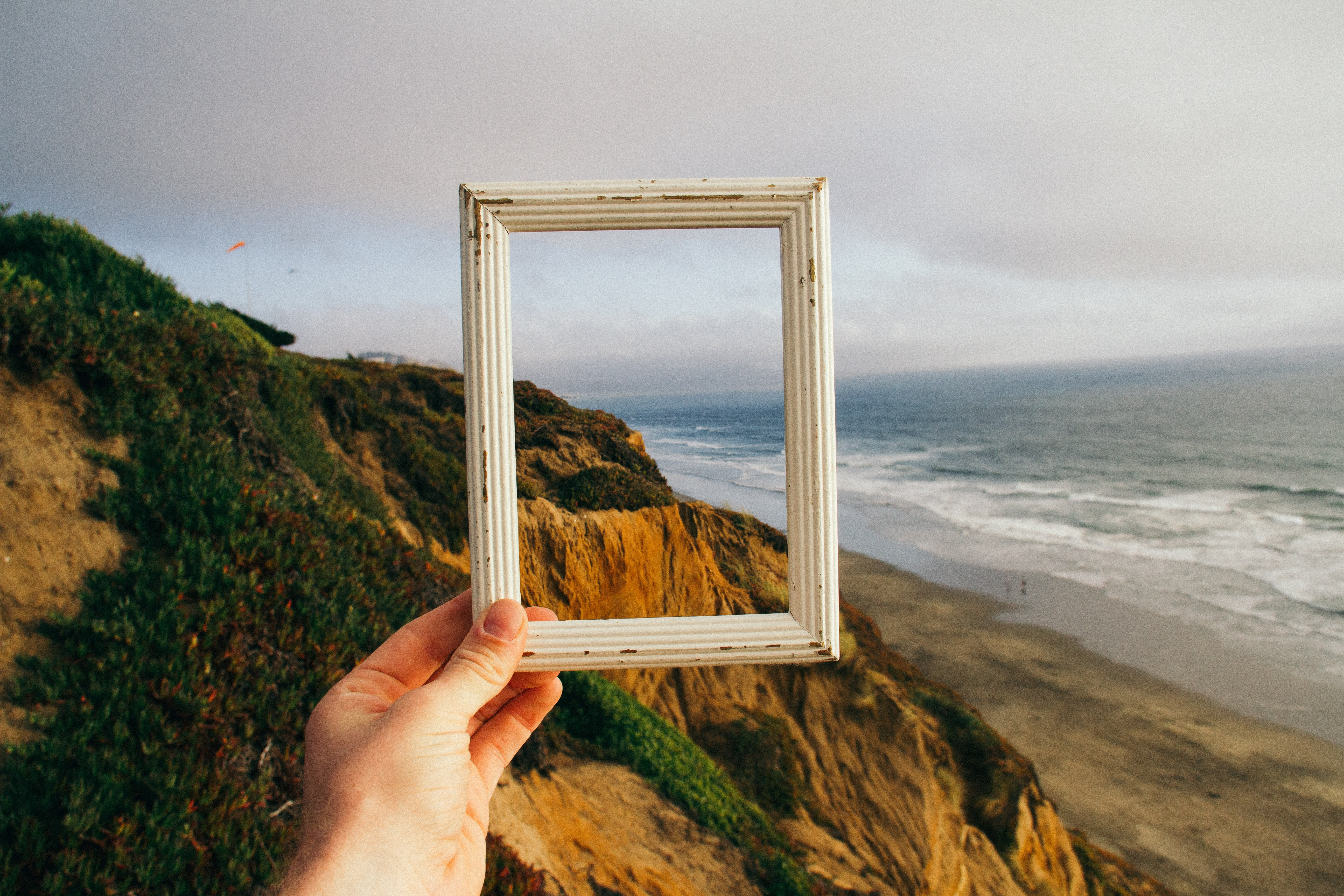 person hand holding photo frame