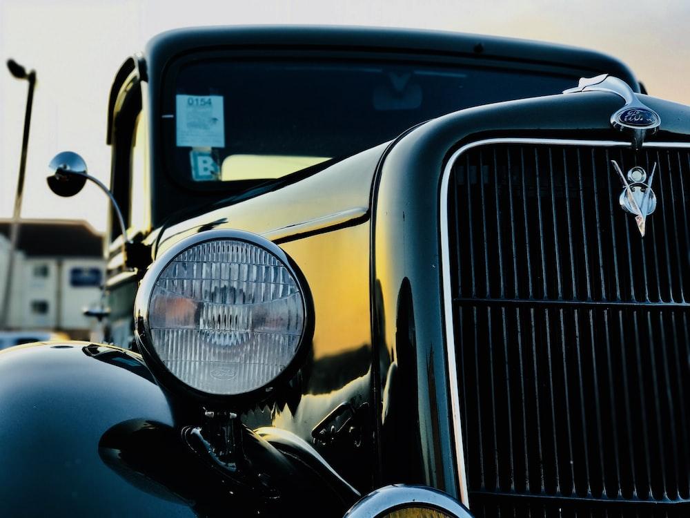 closeup photography of vehicle headlight
