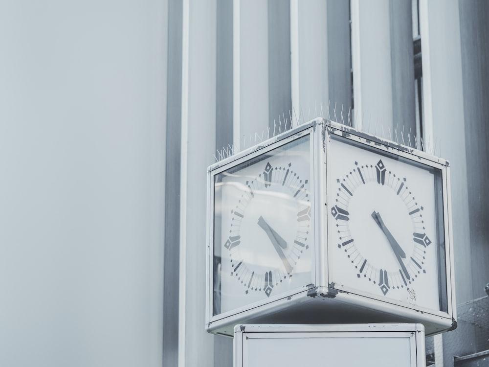 silver framed clock at 4:25