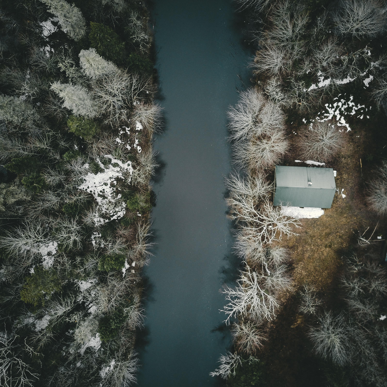 bird's eye view photo of gray house near river