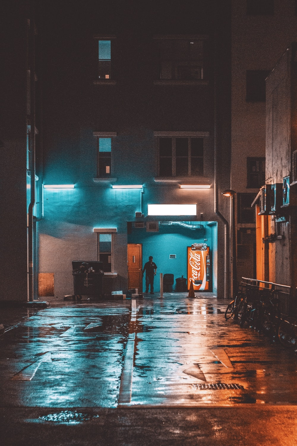 man standing in front building during night time