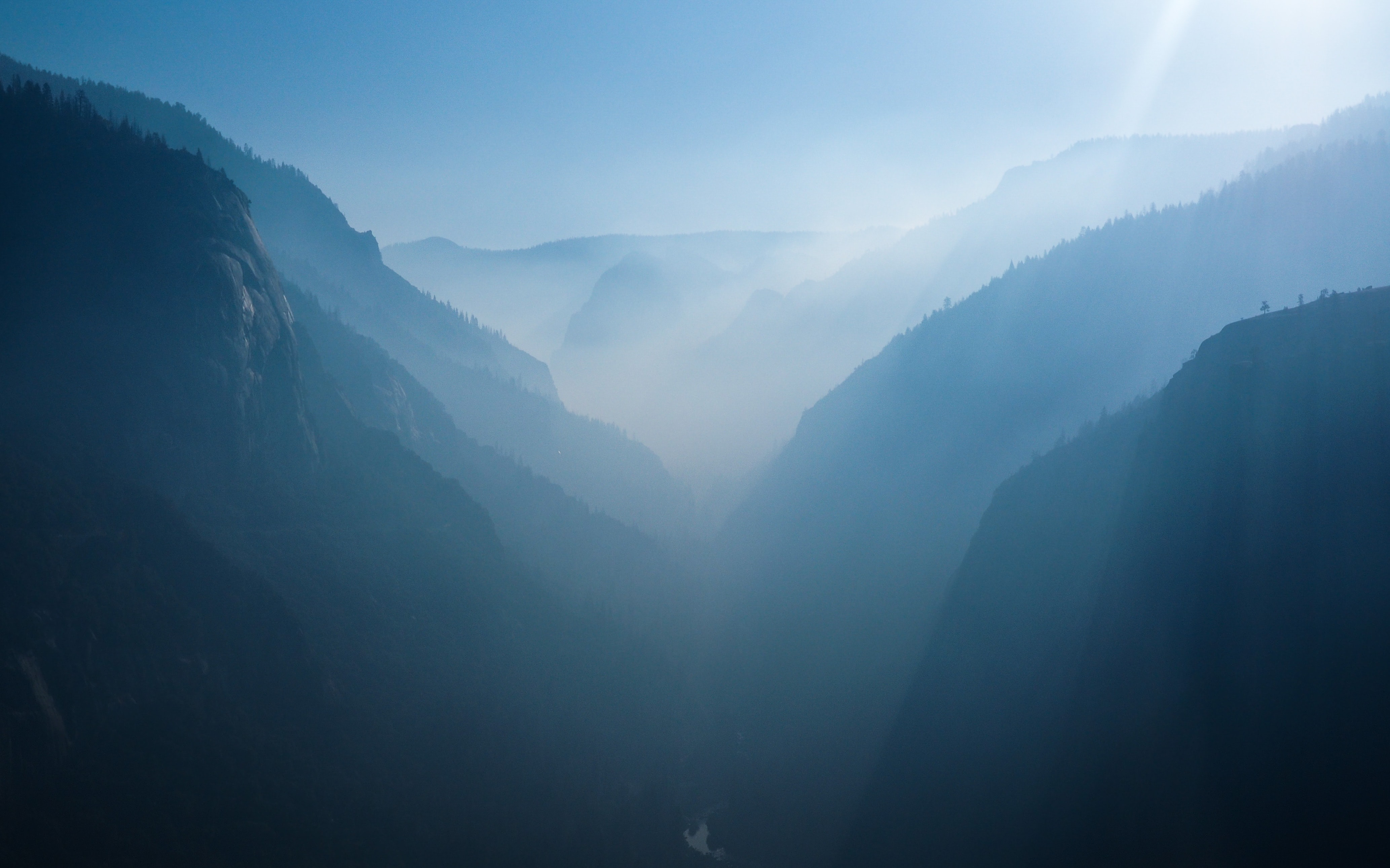 aerial photo of mountains covered with mist