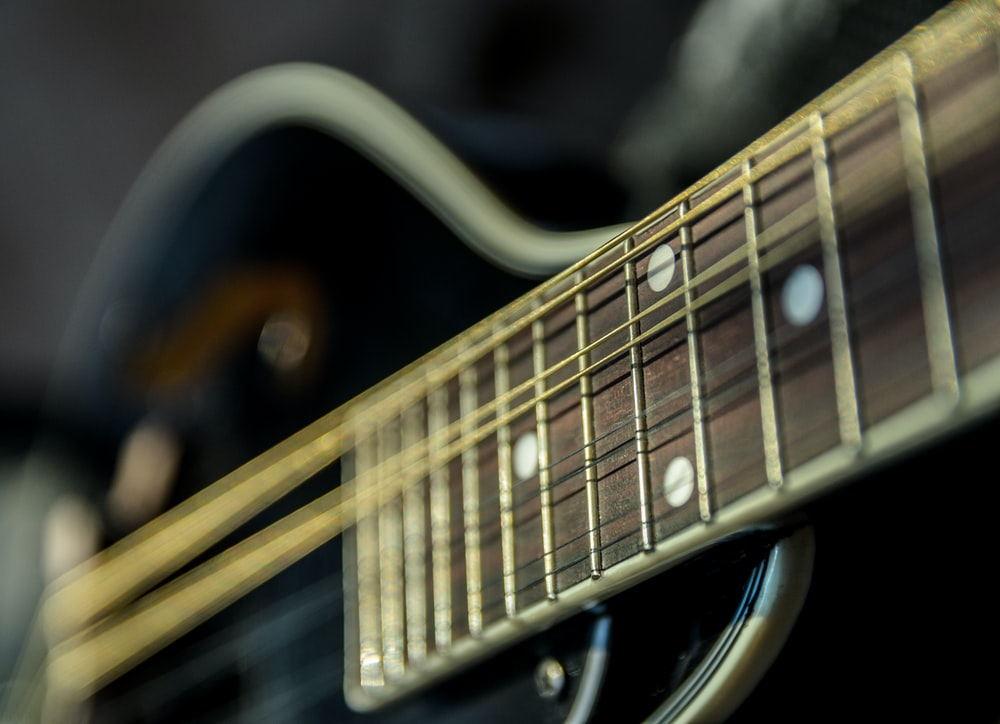 selective focus photography of guitar
