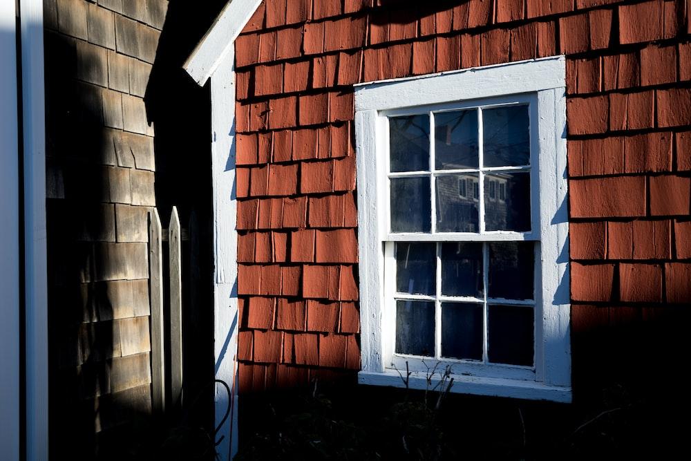 white windowpane and brick wall house