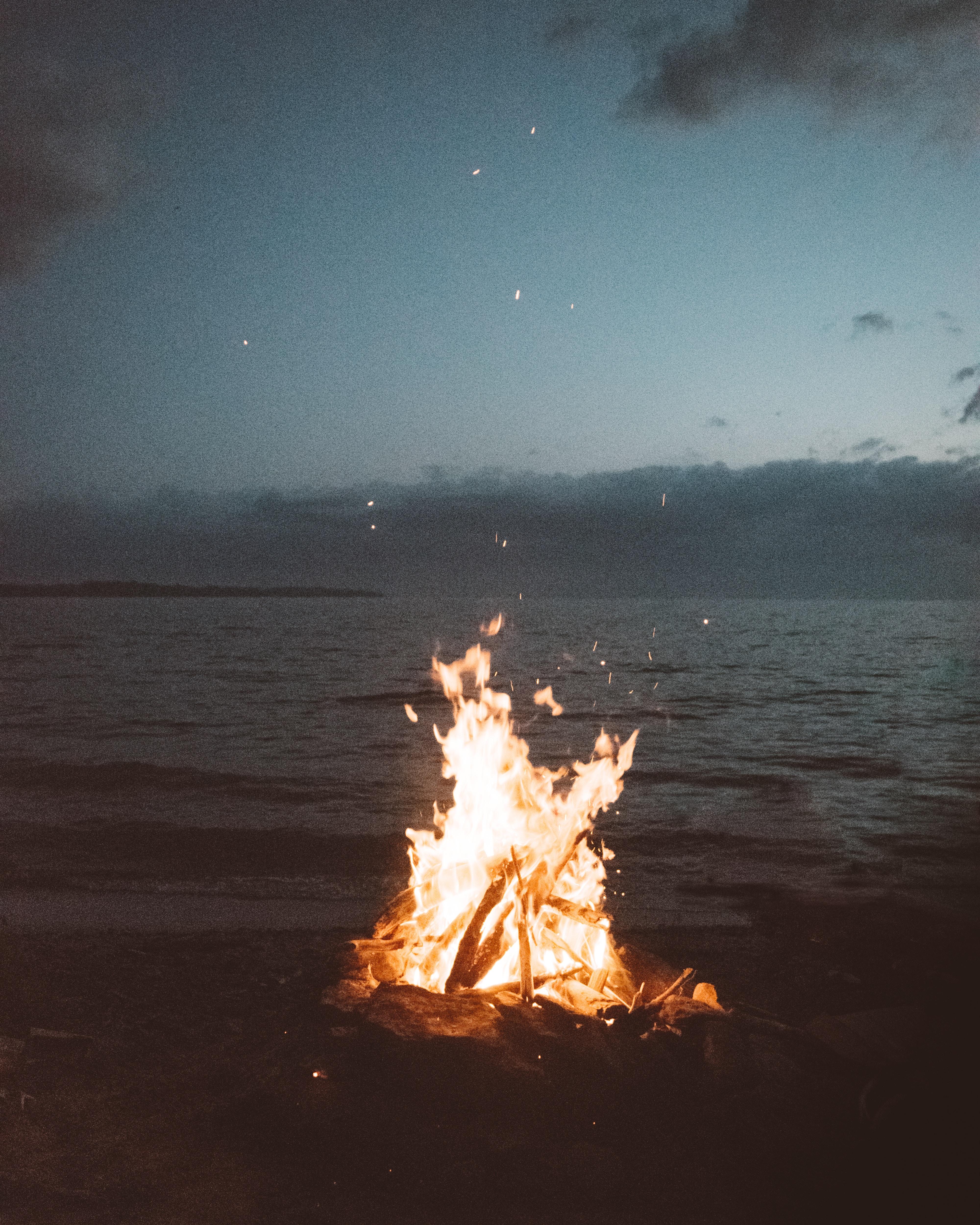 bonfire near seashore during nighttime
