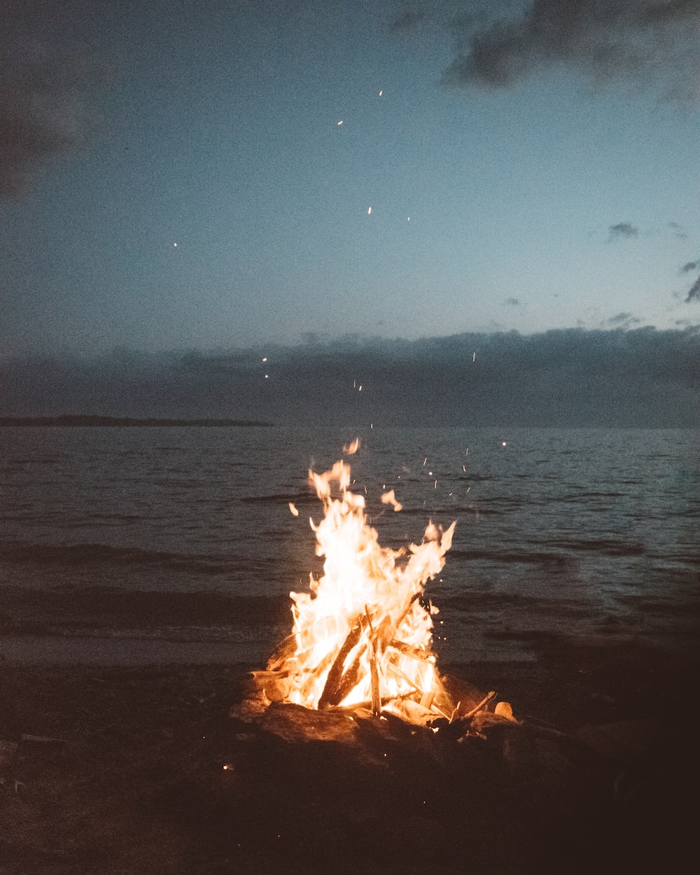 bonfire near seashore during nighttime