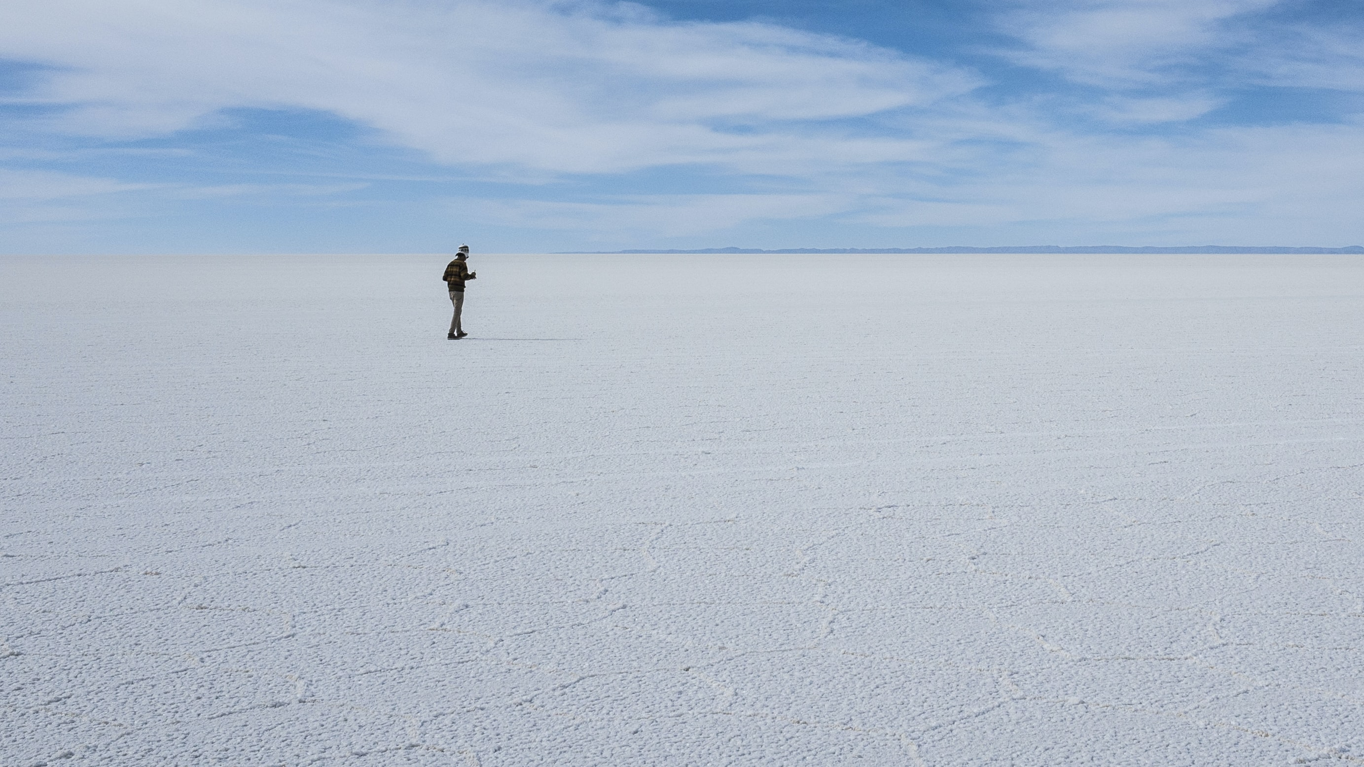 person walking on white open field at daytime