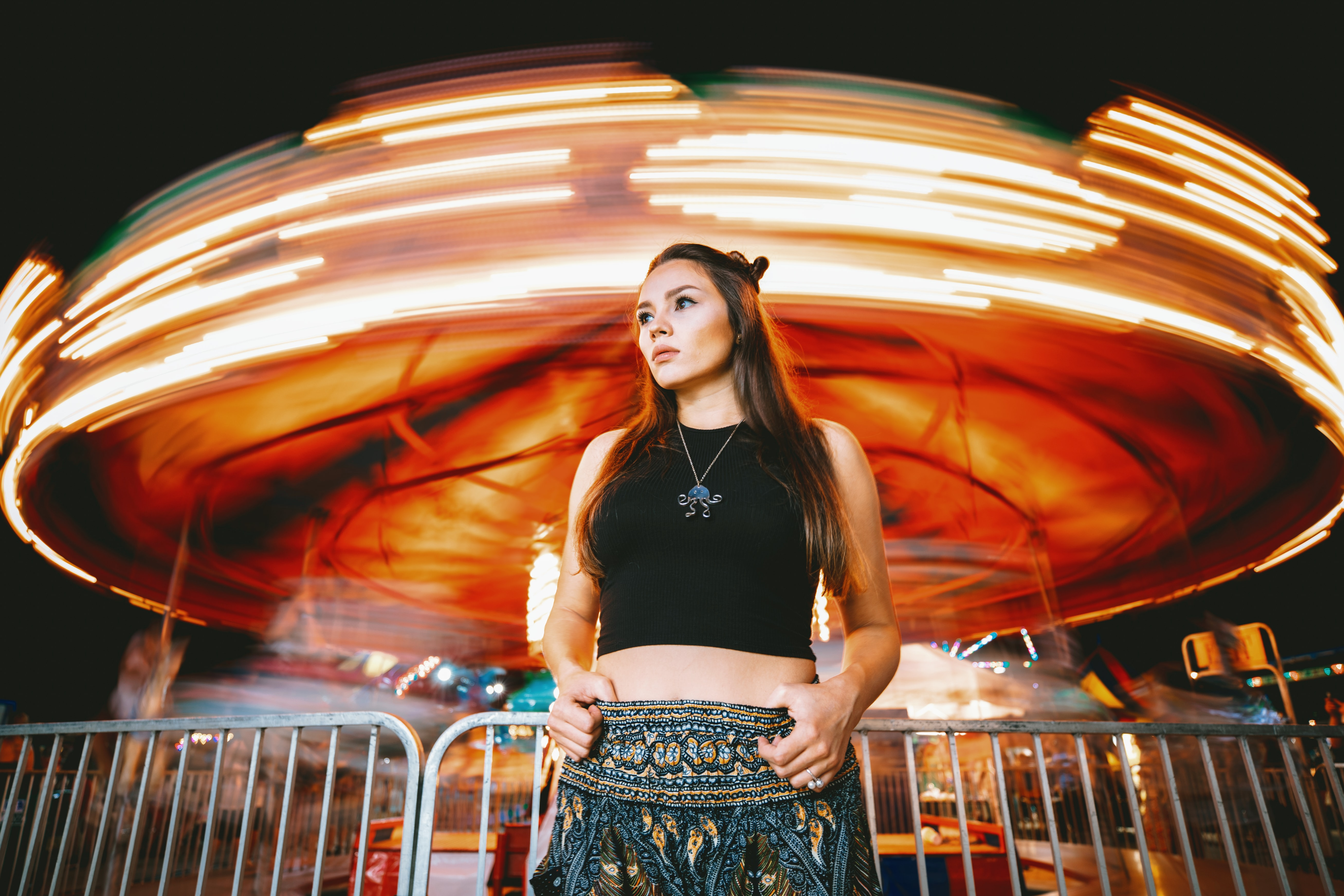 woman in front-of carousel